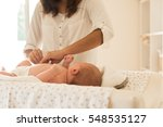 mother changing a diaper on... | Shutterstock . vector #548535127