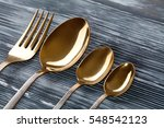 gold spoons and fork on the... | Shutterstock . vector #548542123