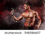 muscular man with protein drink ...   Shutterstock . vector #548586607