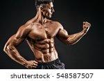bodybuilder posing. beautiful... | Shutterstock . vector #548587507