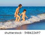 little kids go to swim in sea... | Shutterstock . vector #548622697