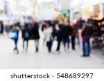 people walking on shopping... | Shutterstock . vector #548689297