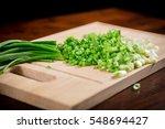 sliced green onion stems on... | Shutterstock . vector #548694427