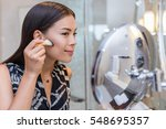 asian woman putting makeup in... | Shutterstock . vector #548695357