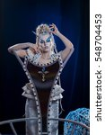 Small photo of emotional actress woman in makeup and costume elf queen on blue-black background