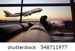 Woman Playing Smartphone At...