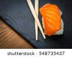 Sushi And Sashimi Rolls On A...