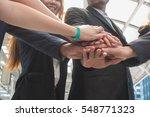 hands of a businessman holding... | Shutterstock . vector #548771323