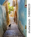 Small photo of Old Stone Street Alleyway Black Cat Safed Tsefat Israel Many famous synagogues located in Safed.