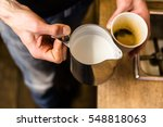 barista preparing to add milk... | Shutterstock . vector #548818063