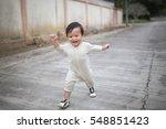 little baby boy walking along... | Shutterstock . vector #548851423