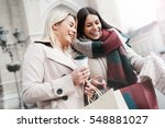 two attractive young women... | Shutterstock . vector #548881027