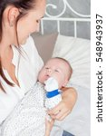 young mother holding her baby... | Shutterstock . vector #548943937