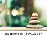 stack of zen stones on ground... | Shutterstock . vector #549128317