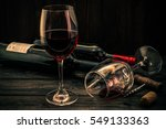 Two Bottles Of Red Wine With...