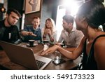 young friends looking at laptop ... | Shutterstock . vector #549173323