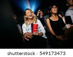 young people laughing while... | Shutterstock . vector #549173473