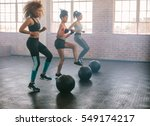 young women exercising in... | Shutterstock . vector #549174217