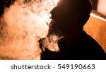 young handsome guy smoking... | Shutterstock . vector #549190663