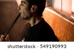 young handsome guy smoking... | Shutterstock . vector #549190993