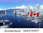 Stock photo canadian flag in front of view of false creek and the burrard street bridge in vancouver canada 549375997