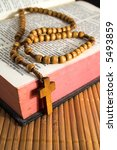 open bible with rosaries beads... | Shutterstock . vector #5493859