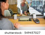 Small photo of people, withdrawal, saving and finance concept - clerk with cash money and customer at bank office or currency exchanger