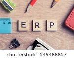 Small photo of ERP abbreviation made of wooden cubes and office stationary
