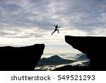 man jump through the gap... | Shutterstock . vector #549521293