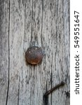 Old Rusty Screw On Wood