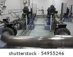 Pumping, pipes and valves in a water treatment plant. - stock photo