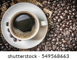 coffee cup and coffee beans on... | Shutterstock . vector #549568663
