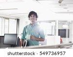portrait of smiling businessman ... | Shutterstock . vector #549736957