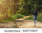 Young Woman Running On A Trail...