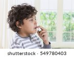 boy using  nasal spray bottle.  ... | Shutterstock . vector #549780403
