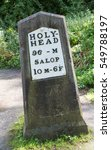 Small photo of An old British road sign showing distances to Hollyhead and Salop