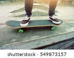 young skateboarder legs riding... | Shutterstock . vector #549873157