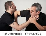 Small photo of Kapap instructor demonstrates street fighting self defense technique against holds and grabs with his student
