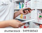 pharmacist looking at... | Shutterstock . vector #549938563