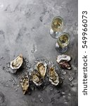 open oysters and champagne on... | Shutterstock . vector #549966073