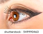 woman eye with makeup and long... | Shutterstock . vector #549990463