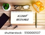 Small photo of Business Concept - Top view of smartphone, earphone, plant, eye glasses, alarm clock, pen and notebook written with ACCOUNT RECEIVABLE on wooden background.