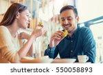 happy loving couple enjoying... | Shutterstock . vector #550058893