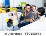Happy European Parents With Tw...
