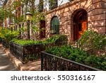 row of townhouses and front... | Shutterstock . vector #550316167