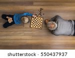 small boy laying on the wooden... | Shutterstock . vector #550437937