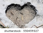 heart shaped hollow hole in... | Shutterstock . vector #550459327