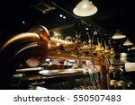golden shiny beer taps in beer... | Shutterstock . vector #550507483