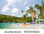 sailing boats in marigot bay | Shutterstock . vector #550545823