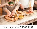 the yong people cuts bread and... | Shutterstock . vector #550695637